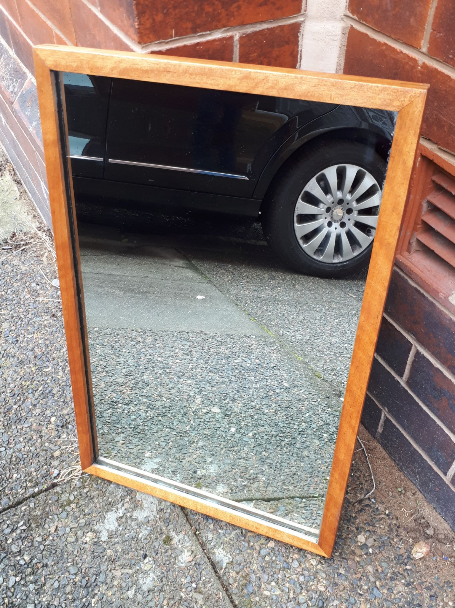 vintage wood framed rectangular mirror with chain circa 1950s office